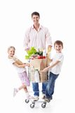 Fun. Family with cart on a white background Stock Photography