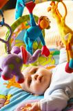 Fun. Little girl with colorful toys royalty free stock images