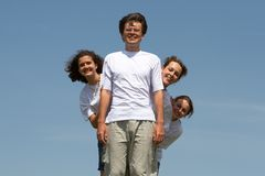 Fun. Young the man stands, and three girls look out at him because of a back Royalty Free Stock Photo