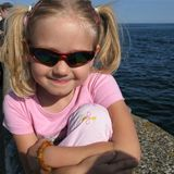 Fun. Young girl having fun by the sea in the harbour of Gdynia Stock Image