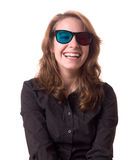 Fun with 3-D. Laughing young woman with anaglyph 3-D glasses Stock Image