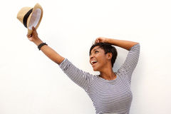 Fun african american girl cheering with arms raised royalty free stock photo