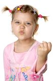 Fun angry girl. Fun angry little girl. Isolate on white Royalty Free Stock Image