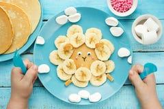 Fun animal shaped pancake with banana, sheep pancake Stock Image