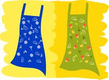 Fun Aprons with food icons. Illustration of a pair of aprons with food item designs and icons print Royalty Free Stock Image