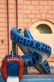 Fun in aqua park. A little boy having fun in aqua park, on water slide Stock Image