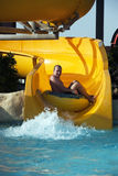 Fun in aqua park. Boy having fun in aqua park, on water slide Stock Image