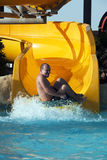 Fun in aqua park. Boy having fun in aqua park, on water slide Royalty Free Stock Photography