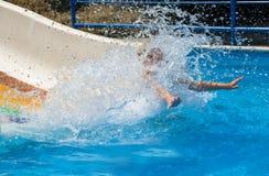 Fun in the aqua park. Young girl having fun in aqua park Stock Images