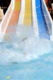 Fun in aqua park. With water splash Stock Photo