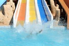 Fun in aqua park. With water splash Stock Photography