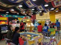Fun at the arcade. Enjoying moments playing games and earning tickets and coins  at an arcade at SM Consolacion Cebu Stock Photography