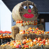 Fun autumn produce display on hay bales Royalty Free Stock Images