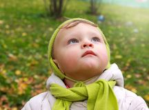 Fun baby looking up with serious stock image