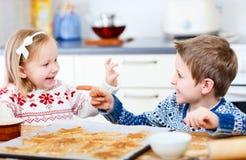 Fun baking. Two little kids having fun while baking cookies Stock Photos