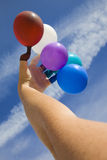 Fun with balloons against the sky Stock Image