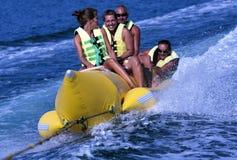 FUN BANANA BOAT. People riding on a banana boat stock image