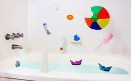Fun in bathroom, falling toys, accessories Royalty Free Stock Images