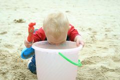 Fun on the beach. Small child exploring a beach in Cornwall Stock Photos