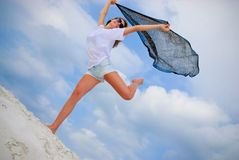 Fun on the beach. Girl enjoys fresh breeze on the beach Stock Photo