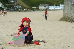 Fun on the beach. Small child exploring a beach in Cornwall Royalty Free Stock Images