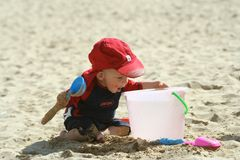Fun on the beach. Small child exploring a beach in Cornwall Stock Photo