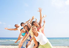 Fun on the beach. Group of young people having fun on the beach Royalty Free Stock Images