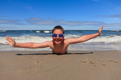 Fun on the beach. Boy having fun on beach after swimming Stock Photo