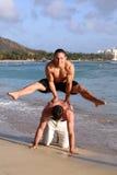 Fun on the beach. Two teenage boys having fun on the beach Royalty Free Stock Photo