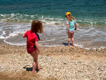 Fun in the beach. Two children in the beach Royalty Free Stock Image