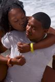 Fun on beach. Attractive African-American young couple playing on beach Stock Images