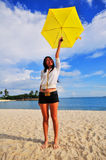 Fun at the Beach 4. Smiling girl on the beach with an umbrella Stock Photography