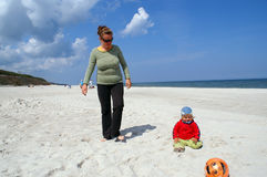 Fun on beach. Mum and they entertain on beach daughter case royalty free stock images
