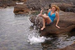 Fun at the beach. Young woman having fun at beach Stock Photo