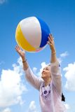 Fun at the beach with a beachball Stock Photography