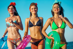 Fun on the beach. Girls wearing  bikini with lifebuoys on beach Royalty Free Stock Photos