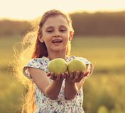 Fun Beautiful Kid Girl With Long Hair Joying And Holding Green A Stock Images