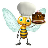 fun Bee cartoon character with cake and chef hat Stock Images