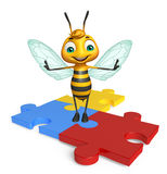 Fun Bee cartoon character  with puzzle Stock Photo