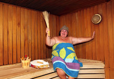 Fun big woman in sauna Royalty Free Stock Photos