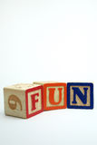 FUN blocks. Arrangement of alphabet blocks spelling out the word fun in capital letters stock images