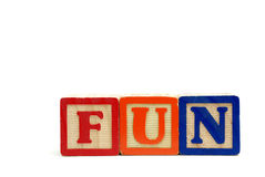 FUN blocks - Upper case. Arrangement of alphabet blocks spelling out the word fun in uppercase letters royalty free stock photography