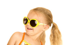 Fun blond girl leaning back wearing sunglasses portrait Stock Images