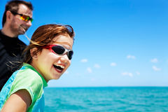 Fun boat ride. Young girl enjoying a boat ride, leaning out for a better view Royalty Free Stock Photos
