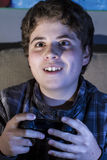 Fun boy with joystick playing computer game at home. Stock Images
