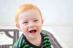 The fun boy laughs. Looking at the camera royalty free stock photography