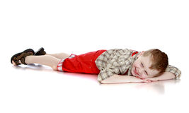 Fun boy lying on the floor stock photography