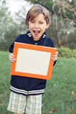 Fun boy with a sign Stock Images