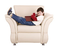 Fun boy sleep with book. Isolated Stock Images