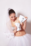 Fun bride broke a photo which shows the groom Royalty Free Stock Image